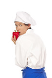 Young woman dressed as a cook with useful food poster