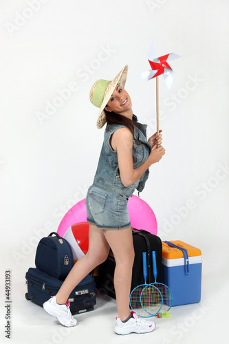 girl with windmill toy ready for holidays