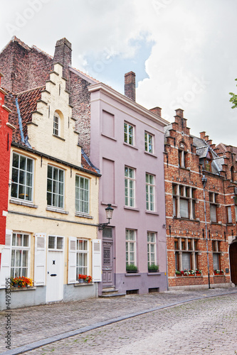 European small street with old brick houses. Bruges. Belgium.