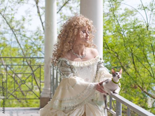 Princess with cat on the terrace (half-length portrait)