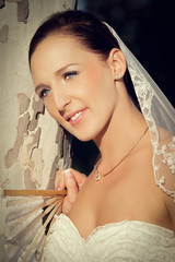 Bride in white dress with fan