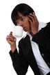 businesswoman talking on her cell and drinking coffee
