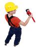 female plumber holding spanner