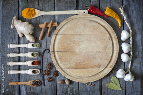 Exotic spices and empty cutting board food background