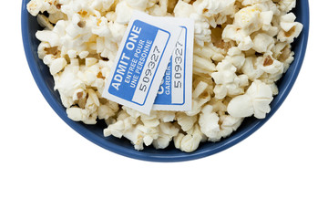 blue bowl with popcorn and cinema tickets