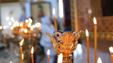 Russian Orthodox Church. Burning candles on a candlestick