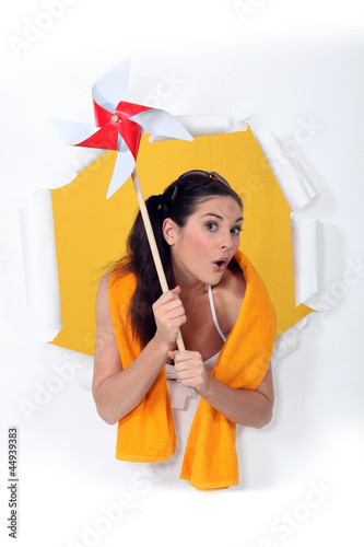 Woman holding toy windmill