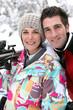 Portrait of couple in ski resort
