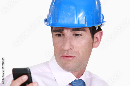 Architect looking at a cellphone