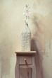 Wooden cupboard with white orchid beside the grunge, beige wall