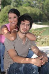 Couple sitting by a lake