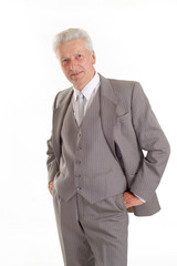 Serious elderly man in suit