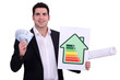Man holding money and energy efficiency poster