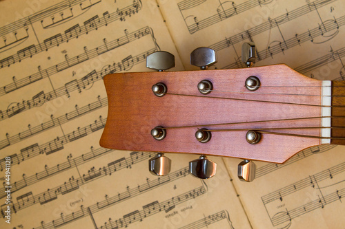 guitar and old musical notes