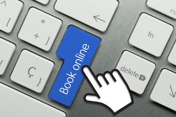 Book online. Hand. Keyboard key