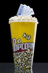 popcorn and tickets isolated on the dark background