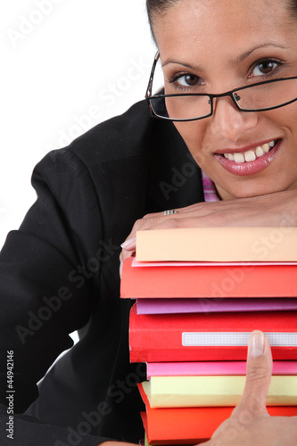 employee holding a stack of files