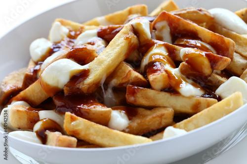 poutine, canadian cuisine - 44942534
