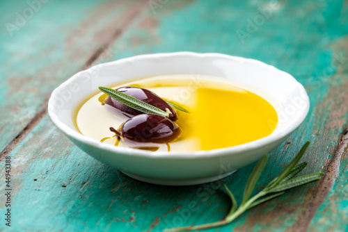 Kalamata olives in a bowl of olive oil