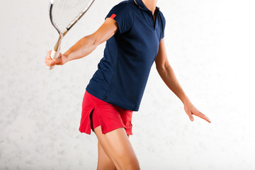 Squash racket sport in gym, woman playing