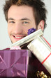 Portrait of a man with gift packages