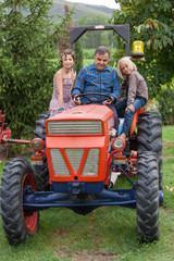 Adult Farmer with Children on Tractor