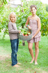 Boy and Girl Holding Basket of Vegetables