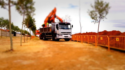Loader truck working in a construction site, tilt shift effect