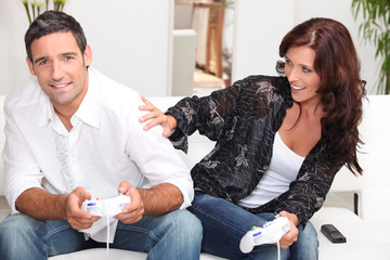 Adult couple playing computer games