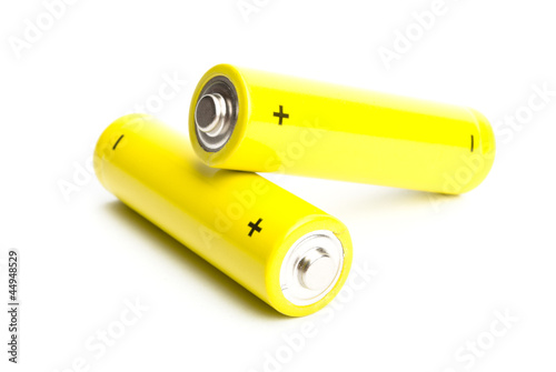 yellow alkaline batteries isolated on white background - 44948529