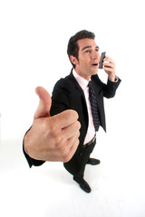 successful businessman on the phone with close up on thumb up