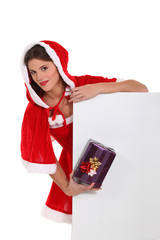 Cute Ms Santa with a gift and a board for your message