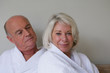 senior couple wearing bathrobes relaxing