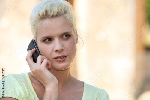 Young summery woman using a cellphone