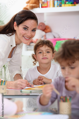 Young teacher and children in a classroom