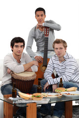 Young men with musical instruments