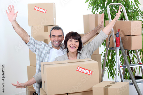 Excited couple on moving day