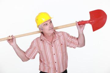 Elderly labourer holding a spade