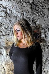 portrait of attractive sexy woman in  the cellar