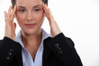 Businesswoman suffering from headache