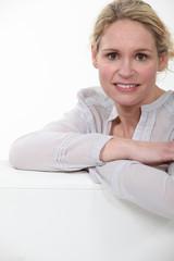 portrait of beautiful blonde in her thirties posing cross-armed