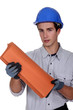 Construction worker holding roof shingles