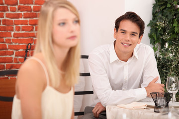 Man admiring blond woman in restaurant