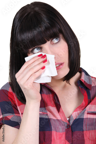 brunette with tissue