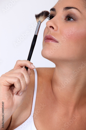 Woman with make-up brush