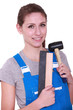 Female labourer holding mallet and sand paper