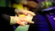 Hand of the Pianist Playing Electric Piano with Lighting