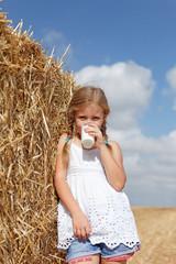 blond girl drinking milk