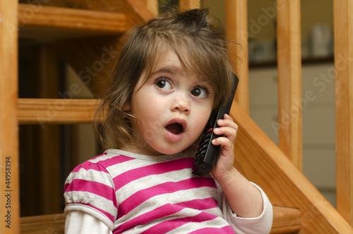 Little girl speak on the phone