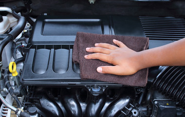 man man wiping car engine for new vehicle